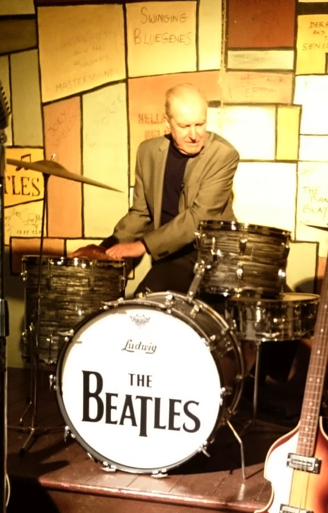 Johnny Hutch Hutchinson sat behind a replica Beatles drum kit. He played with The Beatles twice