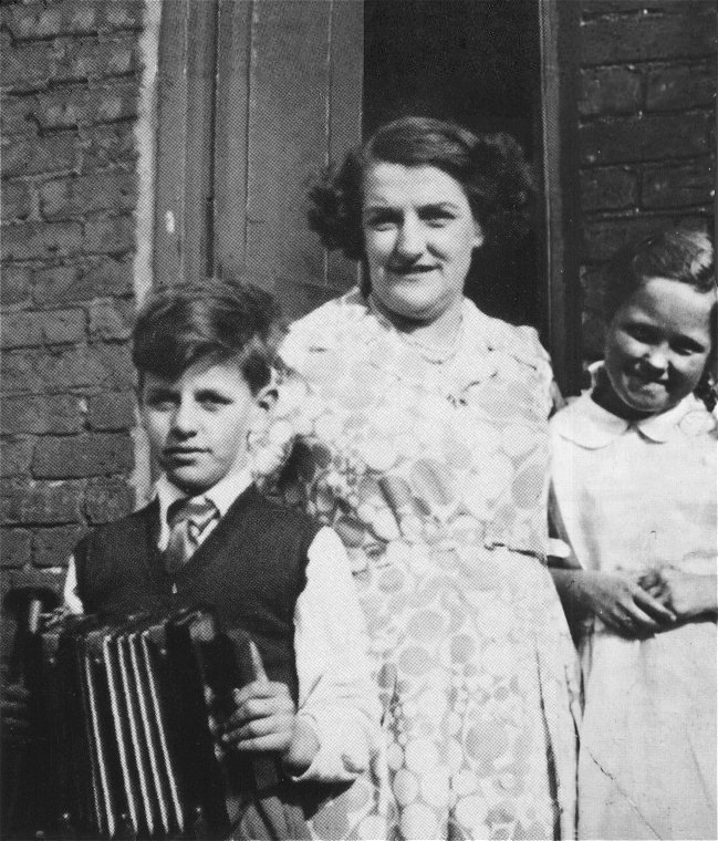 Richy (Ringo) with his mother, Elsie. From playing the accordian, he became The Beatles drummer