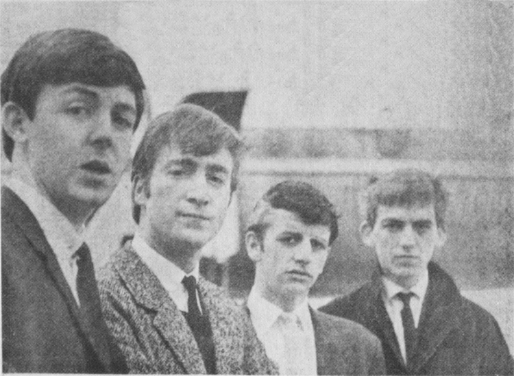 Paul, John, Ringo and George at Speke Airport, ready to go to London. Ringo still has his grey streak, and George a black eye
